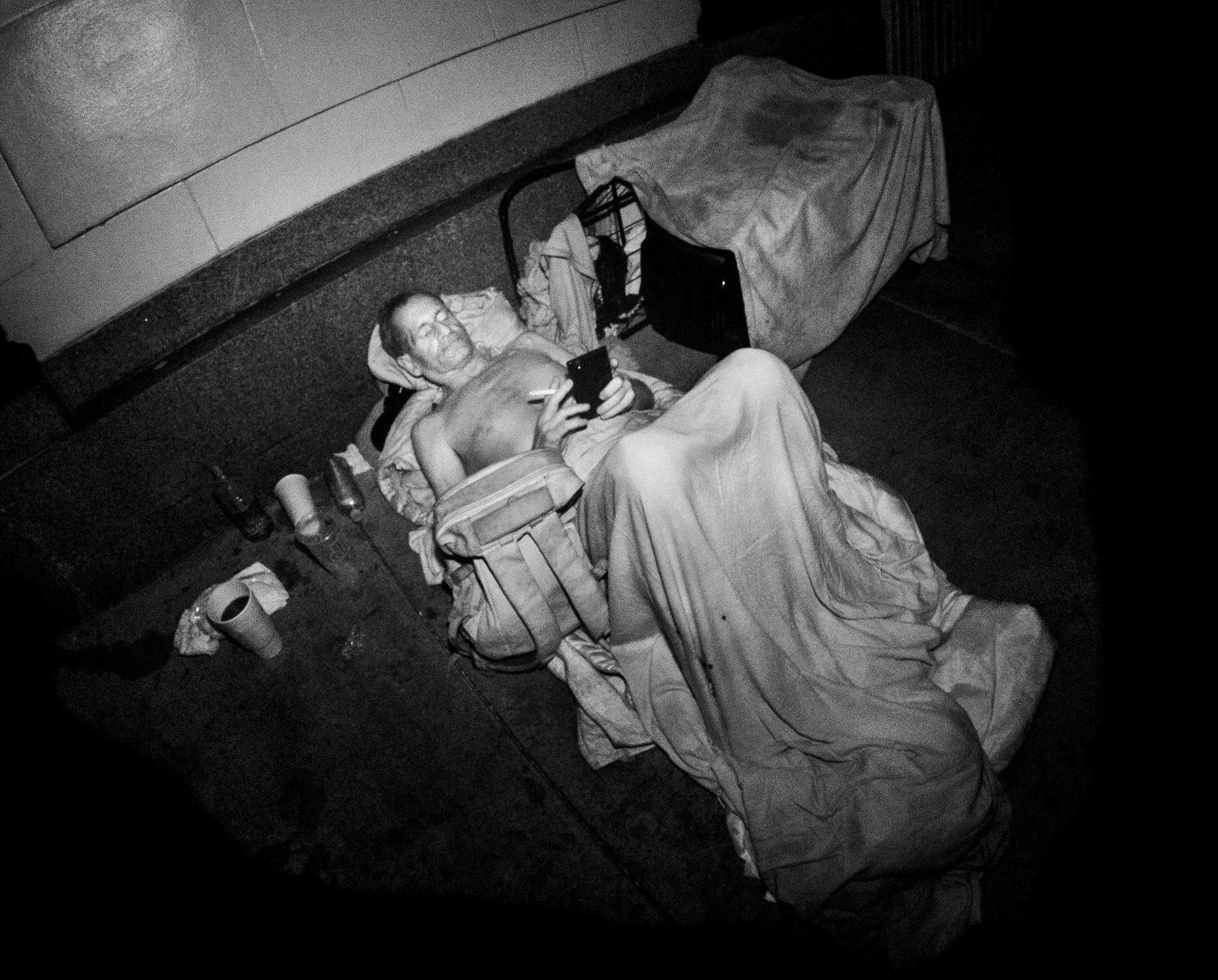 homeless-man-with-cell-phone-infrared-flash-hollywood-ca-2015-daniel-d-teoli-lr.jpg
